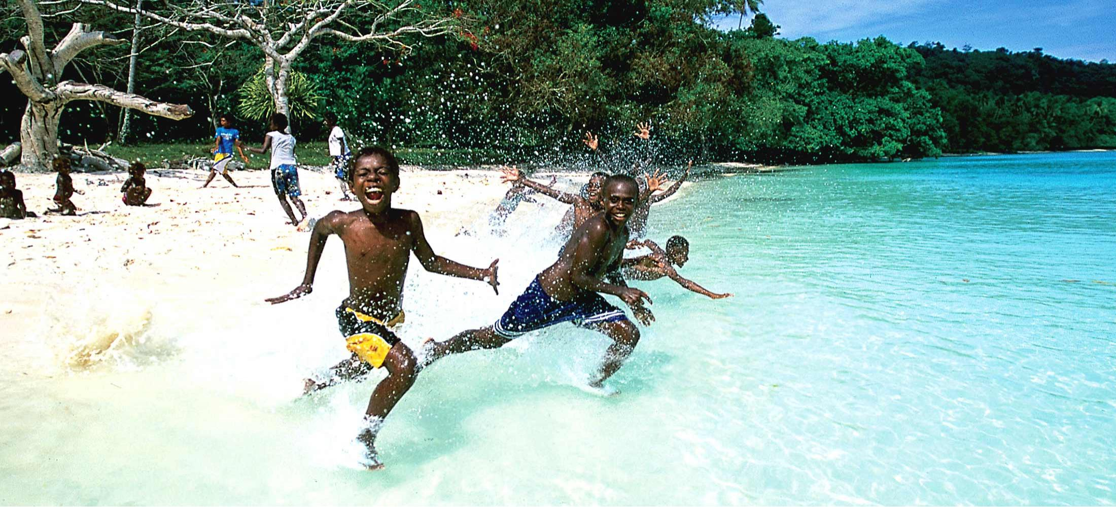 South Pacific tours Vanuatu - children running water